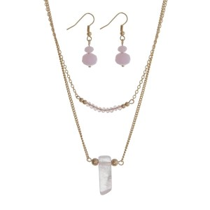 "Gold tone double layer necklace set with pink beads and a natural stone pendant. Approximately 22"" in length."