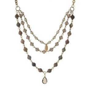 """Gold tone necklace with a triple layer brown and taupe beads. Approximately 18"""" in length."""