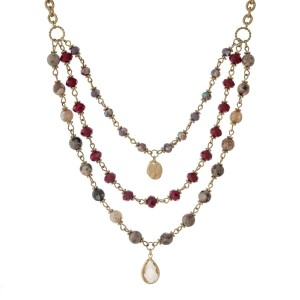 "Gold tone necklace with a triple layer of burgundy and gray beads. Approximately 18"" in length."