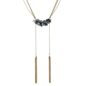 "Burnished gold tone necklace with navy and turquoise beads and two chain tassels. Necklace is approximately 20"" in length and tassels are approximately 5"" in length."