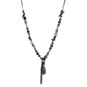 "Silver tone necklace with assorted turquoise beads and a teardrop pendant. Approximately 32"" in length."