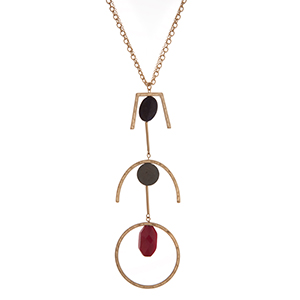 "Gold tone necklace with a geometric pendant accented with navy, gray, and red stones. Approximately 32"" in length."