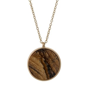 "Gold tone necklace with a reversible picture jasper and gray natural stone circle pendant. Approximately 32"" in length."