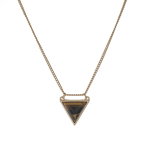 "Dainty gold tone necklace with a tiger's eye triangle stone pendant. Approximately 16"" in length."