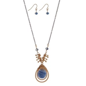 "Two tone necklace set featuring a wire wrapped navy blue teardrop pendant and matching earrings. Approximately 28"" in length."
