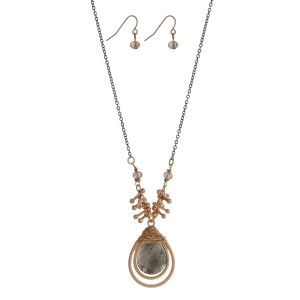 "Two tone necklace set featuring a wire wrapped gray teardrop pendant and matching earrings. Approximately 28"" in length."