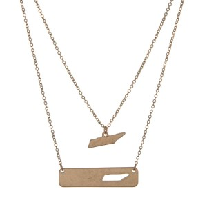 "Gold tone double layer necklace with a Tennessee pendant and a bar with the state shape cutout. Approximately 18"" in length."