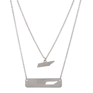 "Silver tone double layer necklace with a Tennessee pendant and a bar with the state shape cutout. Approximately 18"" in length."