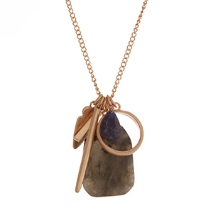 """Gold tone necklace with assorted charms and a faceted gray stone. Approximately 32"""" in length."""