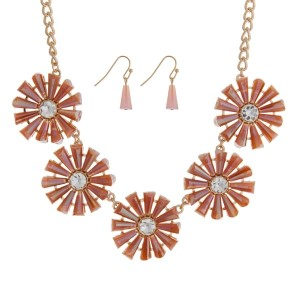 "Gold tone necklace set featuring five peach flowers with clear rhinestones. Approximately 16"" in length."
