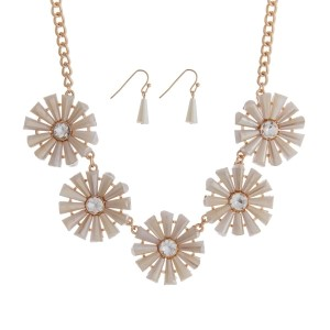 "Gold tone necklace set featuring five ivory flowers with clear rhinestones. Approximately 16"" in length."