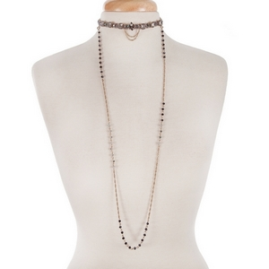 """Gold tone double layer necklace with a navy blue choker and a removable gray and blue beaded long layer. Approximately 32"""" in length."""