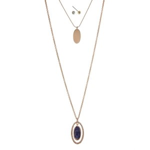 "Gold tone double layer necklace set with a blue lapis stone pendant. Approximately 32"" in length."