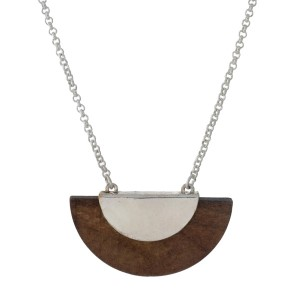 "Silver tone necklace with a wooden half circle pendant. Approximately 27"" in length."