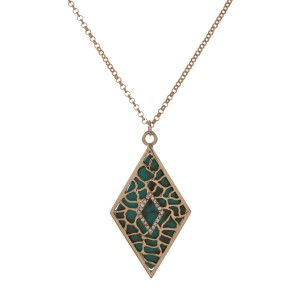 "Gold tone necklace with a turquoise diamond shape pendant. Approximately 18"" in length."