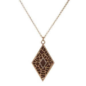 "Gold tone necklace with a taupe diamond shape pendant. Approximately 18"" in length."