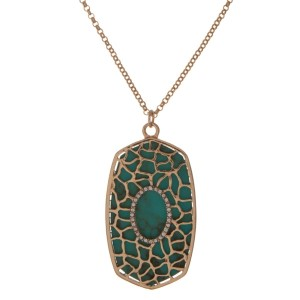 """Gold tone necklace with a turquoise hexagonal shape pendant. Approximately 18"""" in length."""