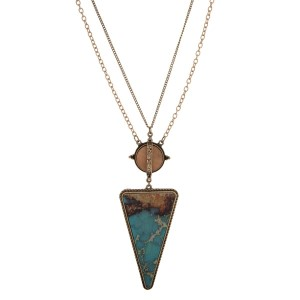 """Burnished gold tone necklace with a wooden turquoise wooden arrow pendant. Approximately 32"""" in length."""