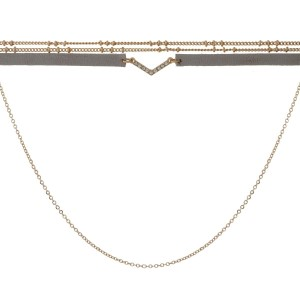 "Gold tone choker necklace with a clear rhinestone 'V' and gray faux leather. Approximately 14"" in length."