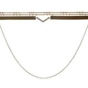 "Gold tone choker necklace with a clear rhinestone 'V' and brown faux leather. Approximately 14"" in length."