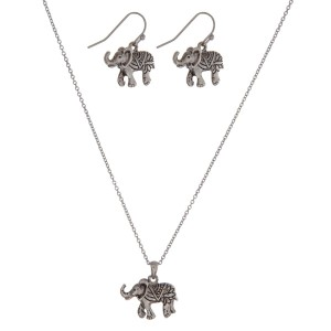 "Dainty silver tone necklace set with an elephant pendant and matching fishhook earrings. Approximately 16"" in length."