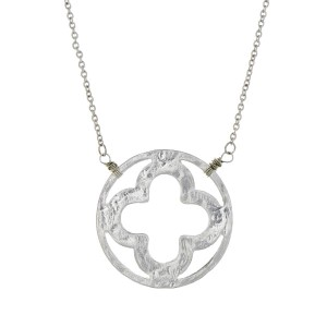"Dainty silver tone necklace with a clover pendant. Approximately 18"" in length."