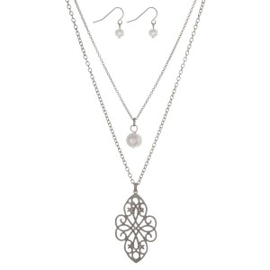 """Silver tone double layer necklace with a pearl bead and a filigree pendant. Approximately 18"""" in length."""