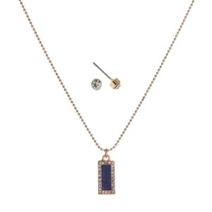"Dainty gold tone necklace set with a blue lapis stone pendant. Approximately 16"" in length."