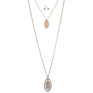 "Gold tone double layer necklace set with a howlite stone pendant. Approximately 32"" in length."