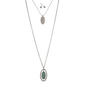 "Silver tone double layer necklace set with a turquoise stone pendant. Approximately 32"" in length."
