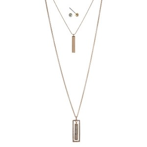 "Gold tone double layer necklace set with a white rectangle stone pendant. Approximately 32"" in length."