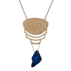 "Gold tone necklace with a hammered pendant and a blue natural stone. Approximately 32"" in length."