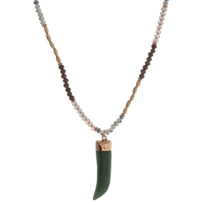 """Gold tone necklace with brown and ivory beads with a green horn pendant. Approximately 32"""" in length."""