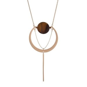 "Matte gold tone necklace with a geometric pendant and tiger's eye circle stone. Approximately 27"" in length."