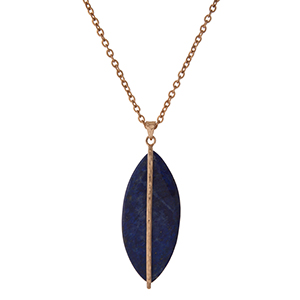 "Gold tone necklace with a sodalite stone pendant. Approximately 32"" in length."
