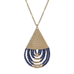 """Gold tone necklace with a half navy blue beaded teardrop pendant. Approximately 32"""" in length."""