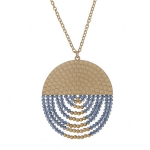 "Gold tone necklace with a half navy blue beaded circle pendant. Approximately 32"" in length."
