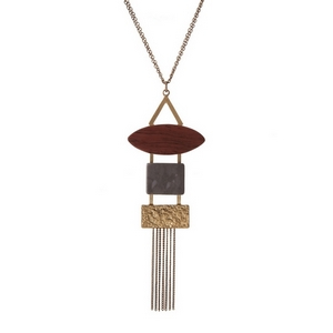 "Gold tone necklace displaying a geometric pendant with gray and burgundy stones. Approximately 32"" in length."