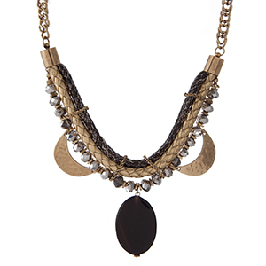 "Gold tone statement necklace with a snake skin pattern, hammered gold tone half circles, gray faceted beads and a black stone pendant. Approximately 16"" in length."