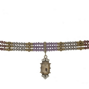 "Gold tone choker with purple, gray and iridescent beads and a faceted topaz stone focal. Approximately 12"" in length."
