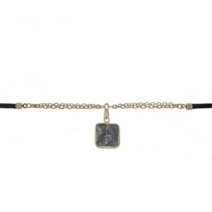 "Black faux suede and gold tone choker with a black natural stone pendant. Approximately 12"" in length."