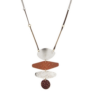 "Silver tone necklace with a hammered burnished gold, silver and burgundy tone geometric pendant. Approximately 32"" in length."