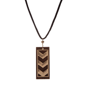 "Brown leather cord necklace with a wooden and gold tone arrow pendant. Approximately 32"" in length."