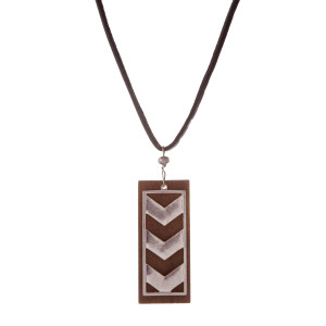 "Brown leather cord necklace with a wooden and silver tone arrow pendant. Approximately 32"" in length."