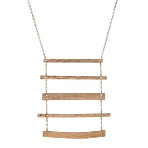 "Gold tone necklace with a five part hammered and textured bar pendant. Approximately 32"" in length."