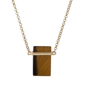 "Gold tone necklace with a rectangle tiger's eye pendant. Approximately 30"" in length."