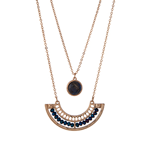 "Gold tone double layer necklace with navy blue beads and a lapis stone. Approximately 30"" in length."