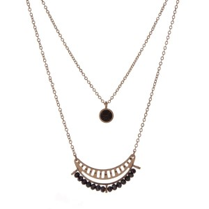 """Gold tone double layer necklace with a black beaded half circle pendant. Approximately 16"""" in length."""