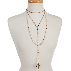 "Gold tone and bronze beaded, layered 'Y' necklace with a cross pendant. Approximately 16"" in length."