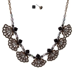 """Burnished gold tone necklace set with black, gray and white opal rhinestones. Approximately 16"""" in length."""